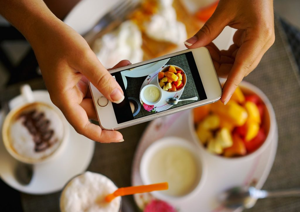 Close-up-of-taking-photo-of-food